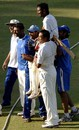 Cheteshwar Pujara is carried off the field by his Saurashtra team-mates