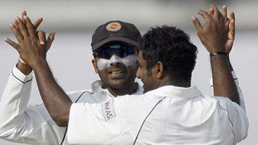 Muttiah Muralitharan is congratulated by Mahela Jayawardene after dismissing Junaid Siddique