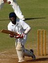 Cheteshwar Pujara watches as the ball bounces off the pitch