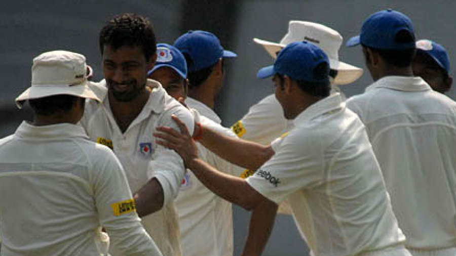 Praveen Kumar celebrates a wicket with his team-mates