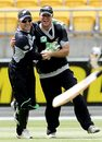 Brendon McCullum hugs Jamie How after he caught Ramnaresh Sarwan