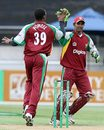 Daren Powell and Denesh Ramdin celebrate the fall of Brendon McCullum's wicket