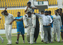 Shivakant Shukla is carried off the field by Praveen Gupta, Tamil Nadu v Uttar Pradesh, Ranji Trophy semi-final, 4th day, Nagpur, January 7, 2009