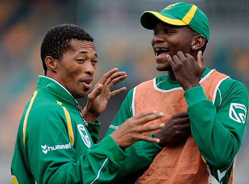 Makhaya Ntini and Lonwabo Tsotsobe mess around during training