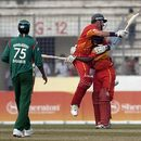 Ray Price and Tawanda Mupariwa celebrate Zimbabwe's win, Bangladesh v Zimbabwe, 1st ODI, Mirpur, January 19, 2009