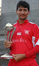 Hong Kong's skipper Tabarak Dar poses with the ICC WCL Division 3 Trophy