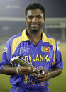 Muttiah Muralitharan with the Man of the Match award, Sri Lanka v New Zealand, 5th match, Champions Trophy, Mumbai, October 20, 2006