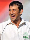 Younis Khan smiles during a domestic game