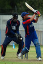 Ainsley Hall watches as Afghanistan's Raees Ahmadzai is bowled, Afghanistan v Cayman Islands, World Cricket League, Buenos Aires, January 30, 2009