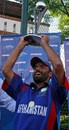Afghanistan captain Nowroz Mangal lifts the ICC World Cricket League Division 3 trophy