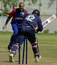 Pearson Best is castled by Hamid Hassan, Afghanistan v Cayman Islands, World Cricket League Division 3, Buenos Aires, January 31, 2009
