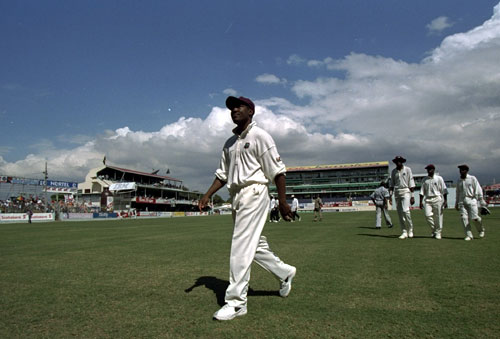 Brian Lara leads his team from the field