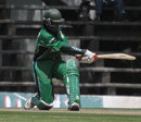 Nehemiah Odhiambo swats the ball towards midwicket, Kenya v Zimbabwe, 3rd ODI, Nairobi, January 31, 2009
