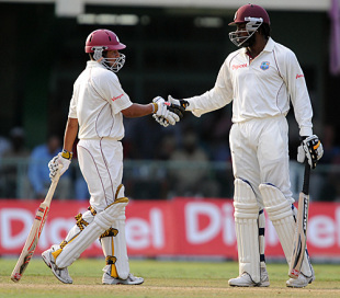 Ramnaresh Sarwan is congratulated on reaching his fifty by Chris Gayle, West Indies v England, 1st Test, Kingston, 2nd day, February 5, 2009