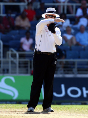 Umpire Tony Hill signals for a review of Shivnarine Chanderpaul's lbw decision, West Indies v England, 1st Test, Kingston, February 6, 2009