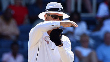 Umpire Tony Hill signals for a review of Shivnarine Chanderpaul's lbw decision