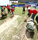 Where are the buckets and spades? Groundsmen dig beneath the surface but find just sand, sand, sand in Antigua, West Indies v England, 2nd Test, St. Johns, Antigua, February 13, 2009