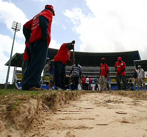 Groundsmen dig beneath the surface of the Antigua pitch and find a sandpit