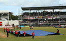 Groundsmen cover the wicket as rain falls, West Indies v England, 3rd Test, Antigua, 1st day, February 15, 2009