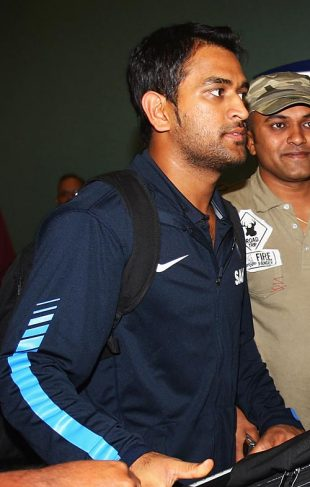 Mahendra Singh Dhoni makes his way out of the airport, Auckland, February 20, 2009