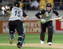 Brendon McCullum and Nathan McCullum take a single