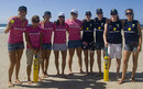 Australian surfers and cricketers pose for photos at a beach cricket game, Gold Coast, March 1, 2009
