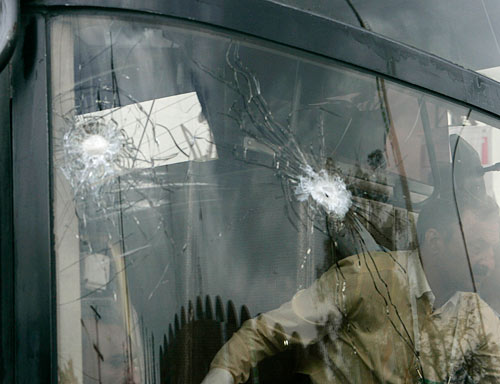 Bullet holes in the windscreen of the Sri Lankan team bus