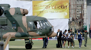 Sri Lankan players prepare to board a Pakistani military helicopter at the National Stadium in Lahore following the terrorist attack, Lahore, March 3, 2009