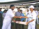 Sandeep Patil handing over the bat of friendship to O Henry SA captain