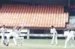 Ajay Kudua pulls Balaji Rao as keeper tries to stop the ball. Ranji Trophy South Zone League, 2000/01, Kerala v Tamil Nadu, Nehru Stadium, Kochi, 29Nov-02Dec 2000.
