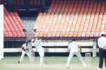Prashanth Menon lifts Vidyuth Sivaramakrishnan. Ranji Trophy South Zone League, 2000/01, Kerala v Tamil Nadu, Nehru Stadium, Kochi, 29Nov-02Dec 2000.