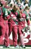 West Indian fieldsman Laurie Williams (2/R) is comforted by wicketkeeper Ridley Jacobs (R), Brian Lara (2/L) and captain Jimmy Adams (L) after hurting himself trying to take a catch looks on in their one day clash against Australia at the MCG in Melbourne 11 January 2000. Australia scored 267-6 off their 50 overs with the West Indies about to start their innings.