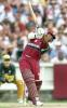 West Indies batsman Brian Lara hits out against the Australian bowling in their match at the MCG in Melbourne, 11 January 2000. Australia scored 267-6 off their 50 overs and then restricted the West Indies to 193-7 from their 50 overs to go one up in the tri-nations series which also includes Zimbabwe