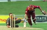 Northern Districts batsman Grant Bradburn is forced to dive back into his crease after being sent back by his batting partner as Central Districts bowler Andrew Schwass fields off his own bowling. Schwass elected not to throw at the stumps. Shell Cup Semi Final: Central Districts v Northern Districts at McLean Park, Napier, 21 January 2001