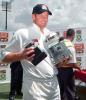 South African captain Shaun Pollock carries 22 January 2001 his trophies of 'Man of the Match' and 'Man of the Series' at close of play of the third and final five-day international played against the visiting Sri Lankans at Centurion Park, Pretoria.