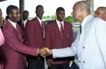 Alcindo Holder, a member of the Young West Indies cricket team, greets Rev. Wes Hall, president of the West Indies Cricket Board, before departing for the Youth World Cup on Thursday.