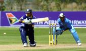 Sri Lanka Under-19 batsman Charith Sylvester shapes to sweep a delivery during his innings of 11 as India Under-19 wicket-keeper Parthiv Patel looks on. ICC Under-19 World Cup Super League Group 1: India Under-19s v Sri Lanka Under-19s at Bert Sutcliffe Oval, Lincoln, 29 January 2002.