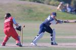 Auckland batsman Helen Watson plays and misses a wide ball outside off stump during her innings of 44 not out. Canterbury wicket-keeper Jo Strachan knocks off the bails without the ball in her gloves, though Watson's back foot remained anchored in the crease. State Insurance Cup Final: Canterbury Women v Auckland Women at Village Green, Christchurch, 10 February 2001.