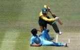 South Africa Under-19 batsman Hashim Amla collides with India Under-19 bowler Rakesh Mohanty as he attempts a run. 1st ICC Under-19 World Cup Super League Semi Final: India Under-19s v South Africa Under-19s at Bert Sutcliffe Oval, Lincoln, 3 February 2002.
