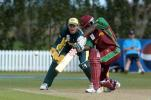 West Indies Under-19 batsman Tonito Willett drives through the covers during his innings of 83. Australia Under-19 wicket-keeper Adam Crosthwaite looks on. 2nd ICC Under-19 World Cup Super League Semi Final: Australia Under-19s v West Indies Under-19s at Bert Sutcliffe Oval, Lincoln, 6-7 February 2002 (7 February 2002).