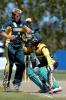 South Africa Under-19 batsman Zwelibanzi Homani (right) makes contact with Australia Under-19 bowler Mark Cosgrove as he turns for a second run during his innings of 52 not out. ICC Under-19 World Cup Super League Final: Australia Under-19s v South Africa Under-19s at Bert Sutcliffe Oval, Lincoln, 9 February 2002.