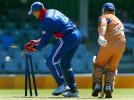 Border Bears Steven Pope survives a run out attempt from England's wicket keeper Marcus Trescothick during their World Cup warm up match against Border Bears at Buffalo Park in East London, South Africa, February 6, 2003.