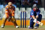 England's skipper Nasser Hussain reverse sweeps as Border Bears' wicket keeper Abongile Sodumo, World Cup warm up match at Buffalo Park in East London, South Africa, February 6, 2003.