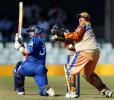 England's skipper Nasser Hussain sweeps behind as Border Bears' wicket keeper Abongile Sodumo, World Cup warm up match at Buffalo Park in East London, South Africa, February 6, 2003.