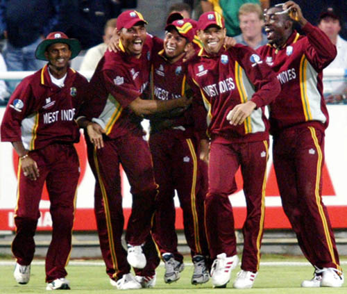 West Indies players celebrate their victory over hosts South Africa in the opening game of the Cricket World Cup in Cape Town