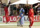 Tatenda Taibu and bowler Guy Whittall celebrate the dismissal of Virenda Sehwag
