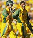 Michael Hussey and Simon Katich are all smiles after wrapping up an easy win, Australia v India, 11th match, VB Series, Perth, February 1, 2004