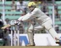India batsman Nayan Mongia slashes at a delivery from Australian bowler Jason Gillepsie during the third day's play of the first test match between India and Australia at the Wankhade stadium in Mumbai 01 March 2001. Mongia scored a fighting 29 runs however India collapsed at 219 and face an almost certain defeat.