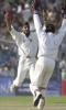 11 March 2001: Indian spinner Harbhajan Singh and team-mate Nayan Mongia celebrate after Singh claimed Australian player Shane Warne to complete a hat-trick on the first day of the second test match between India and Australia at Eden Gardens in Calcutta.