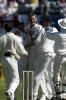 Caddick is congratulated by team-mates after dismissing Parore. 1st Test: New Zealand v England at Christchurch, 13-17 Mar 2002